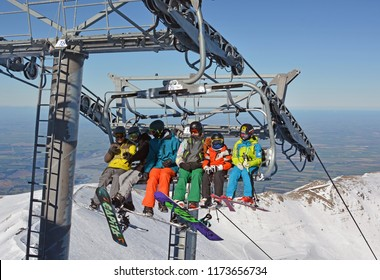 Christchurch, New Zealand - August 19, 2018; Skiers on the Chairlift at the Top of Mount Hutt Ski Field, Canterbury, New Zealand.