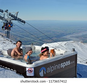 Christchurch, New Zealand - August 19, 2018: Young people in a Spa Bath at the Top of Mount Hutt Ski Field, Canterbury, New Zealand