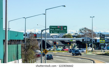 Christchurch, New Zealand - August 27, 2016: Intersection at Blenheim Road and Mandeville street, backdropped with snow capped mountains.