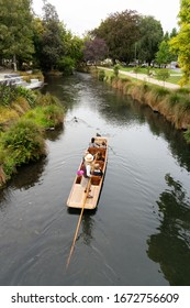 Christchurch, New Zealand - February 22 2020 - Tourists punting on the river Avon in Christchurch's city centre
