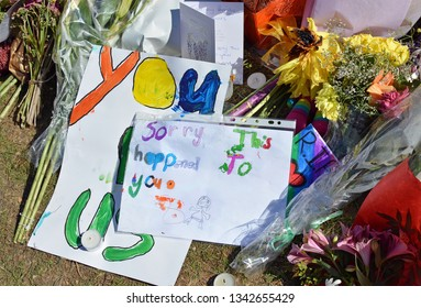 Christchurch, New Zealand - March 19, 2019; Floral tribute & message of Sadness from child to the 50 people shot and killed at two Mosques on March 15, 2019.