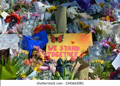 Christchurch, New Zealand - March 19, 2019; Floral tribute & We Stand Together message of Love from Kiwis to the 50 people shot and killed at two Mosques on March 15, 2019.