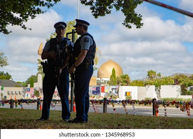 Christchurch, New Zealand, March 22 2019: Policeman silhouetted in front of the Masij El Noor as they stand guard at the Memorial Service to remember the victims of the Christchurch shootings