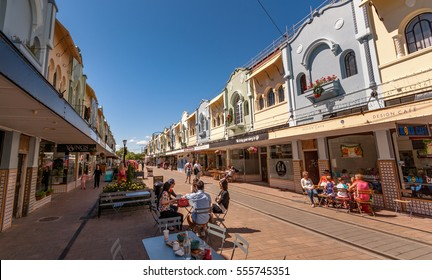 Christchurch, New Zealand - November 29, 2014: People enjoying the cafes and boutiques on the colourful, historic New Regent's Street in Christchurch.