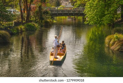 Christchurch, New Zealand - October 03 2017: Tourist enjoying with Punting on the Avon River one of the top tourist attractions and activities in Christchurch, New Zealand.