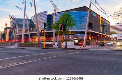 CHRISTCHURCH NEW ZEALAND - OCTOBER 10; example modern architecture glass and  steel curving wavy facade in evening light and light trails from passing vehicles October 10 2018 Christchurch New Zealand