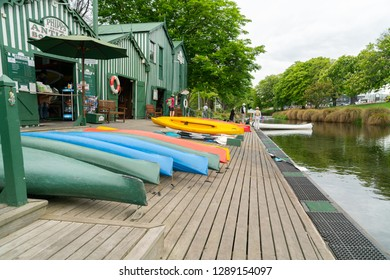CHRISTCHURCH, NEW ZEALAND - OCTOBER 10; Punting on Avon green and white Antigua Boat Sheds along side of river available for people to hire or be punted October 10 2018 Christchurch New Zealand