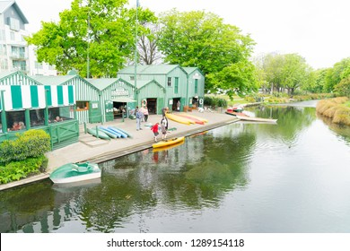 CHRISTCHURCH, NEW ZEALAND - OCTOBER 10; Punting on Avon historic green and white Antigua Boat Sheds along side of river available for people to hire or punted October 10 2018 Christchurch New Zealand