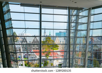 CHRISTCHURCH, NEW ZEALAND - OCTOBER 10; Contrasting architectural styles and eras looking through modern glass and steel facade to city skyline October 10 2018 Christchurch New Zealand