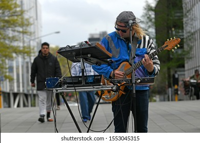 CHRISTCHURCH, NEW ZEALAND, OCTOBER 12, 2019: Musician Reuben Stone entertains a crowd of tourists and spectators near the Christchurch Bridge of Remembrance