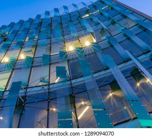 CHRISTCHURCH NEW ZEALAND - OCTOBER 9; Deloitte building example modern architecture glass and vertical Louvre facade in evening light blue tones on October 9 2018 Christchurch New Zealand