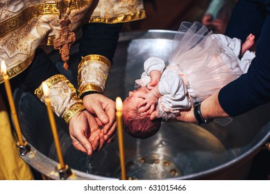 Christening ceremony of little girl in the church