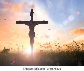 Christian background concept: Silhouette Jesus Christ and cross over meadow sunset