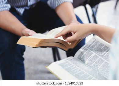 Christian bible god deliver devotional with hand friendship Holy Bible study  reading together in Sunday school