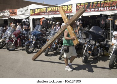 Christian carrying cross for Jesus down Main Street at the 67th Annual Sturgis Motorcycle Rally, Sturgis, South Dakota, August 6-12, 2007