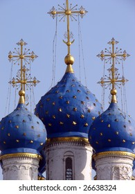 Christian cathedral with the blue domes covered with gold against the dark blue sky