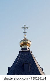 christian church dome with a cross on the sky background