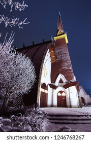 Christian church at night in the winter