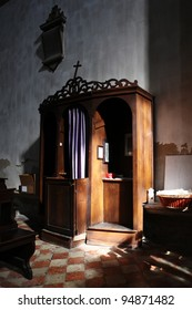 Christian confessional in mysterious light