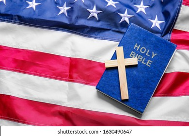 Christian cross and Bible on USA flag
