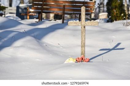 Christian cross in a cemetery in winter
