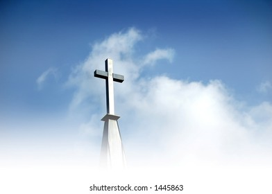 Christian cross in clouds and against blue sky