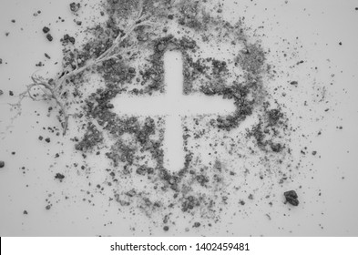 Christian cross, crucifix symbol, sign made in ash, dust, earth.