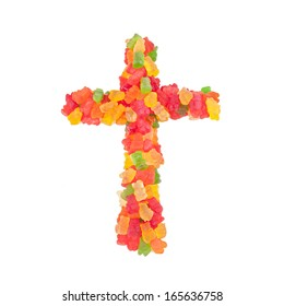 A Christian Cross made from candy isolated against a white background.