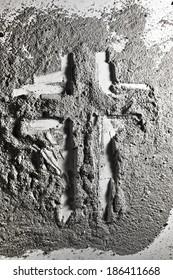Christian cross made of grey ash