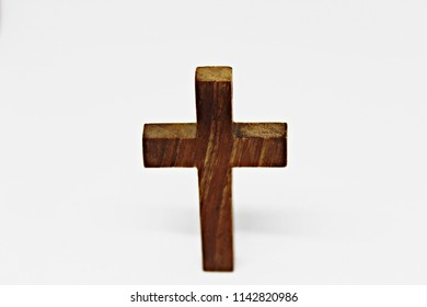 Christian cross made of wood on a white background.