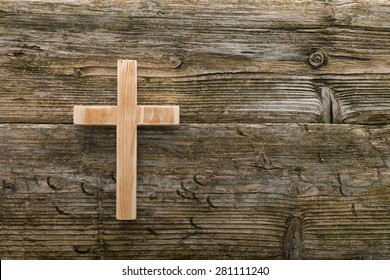 christian cross old wood on wooden  background christianity symbol