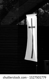 Christian cross on flag in front of a church