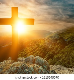 Christian cross with on sunset background. Christ concept