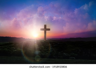 Christian cross outdoors at sunrise. Resurrection of Jesus
