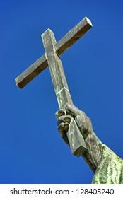 Christian cross over an sky background