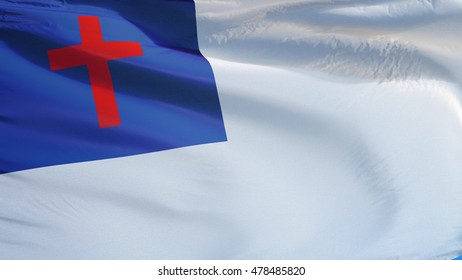 Christian flag waving against clean blue sky, close up, isolated with clipping path mask alpha channel transparency