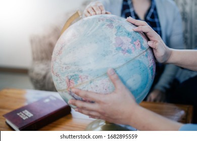 Christian group pray on blurred world globe , Christian background for prayer ministry for the world concept