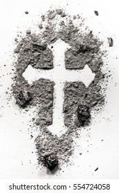 Christian holy cross symbol made in ash, dust as a religion concept