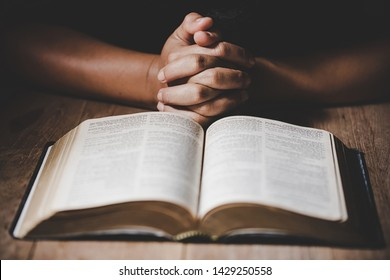 Christian life crisis prayer to god. Woman Pray for god blessing to wishing have a better life. woman hands praying to god with the bible. begging for forgiveness and believe in goodness.