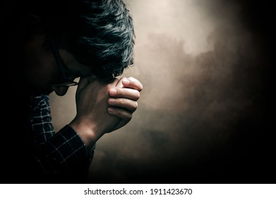 Christian life crisis prayer to god. Man Pray for god blessing to wishing have a better life. man hands praying to god with the bible. believe in goodness. Holding hands in prayer, eyes closed.