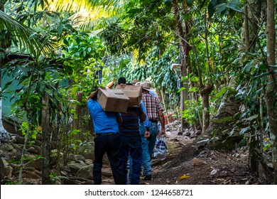 christian missionaries bringing food and supplies to village in Guatemala