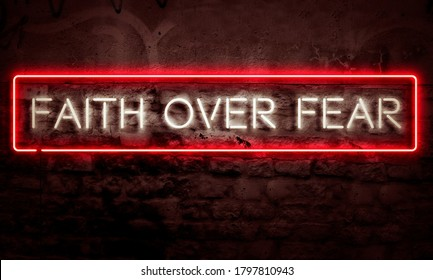 Christian Motivational Word Art Faith Over Fear In Glowing Neon Sign On Grunge Wall