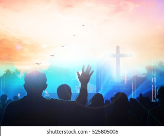 christian music concert with raised hand worship,