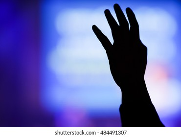 christian music concert with raised hand,Worship GOD concept.Dark tone.Silhouette.