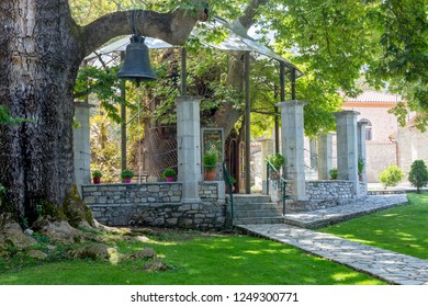 """Christian, Orthodox church """"Panagia Plataniotissa in Kalavryta"""" in the big plane tree (Prefecture of Achaea, Greece, Peloponessus) in the mountains in the summer, sunny day."""
