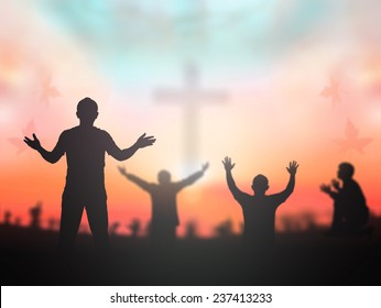 Christian praise and worship concept: Silhouette many people hands raised to pray God over blurred cross in church background