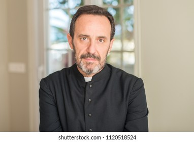 Christian priest man with a confident expression on smart face thinking serious