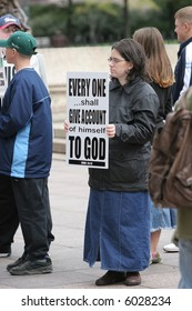 Christian Protesters Carrying Signs