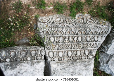 Christian symbols found on pillars  from Ancient Philippi are from the area known as the Bishop's (4th century BC). PIllar includes: Palmetts, Lesbian Sema, Eggs and Dart, bead and reel.