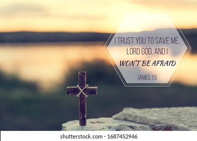 Christian verse bible, James 1:5, saying the Lord will save me and I won't be afraid. Sunrise background with cross